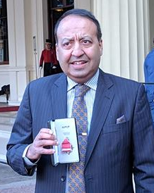 Zuffar Haq receiving his MBE